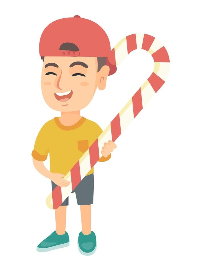 boy with big candy cane