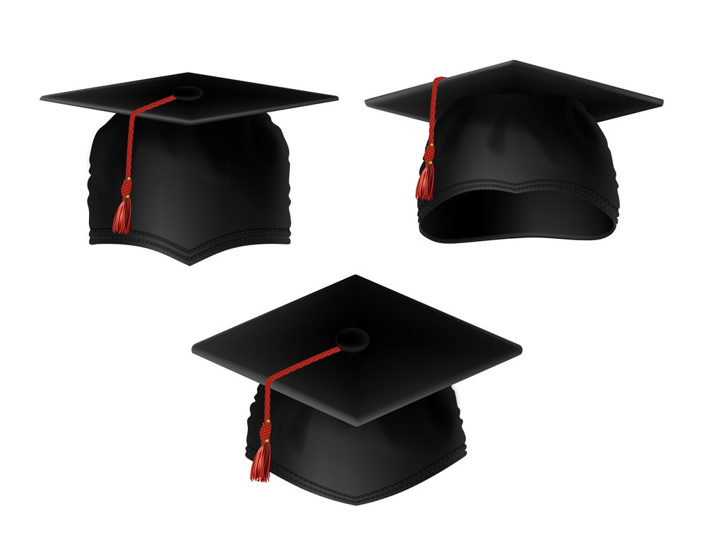 three graduation caps with red tassels