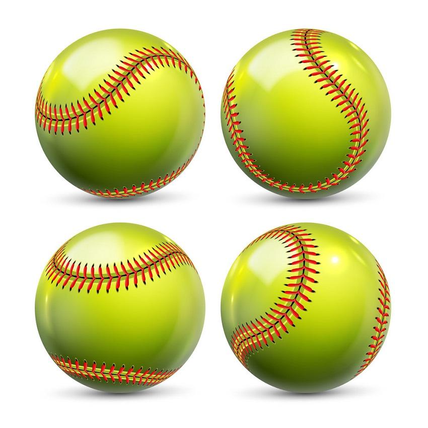 four realistic softball balls