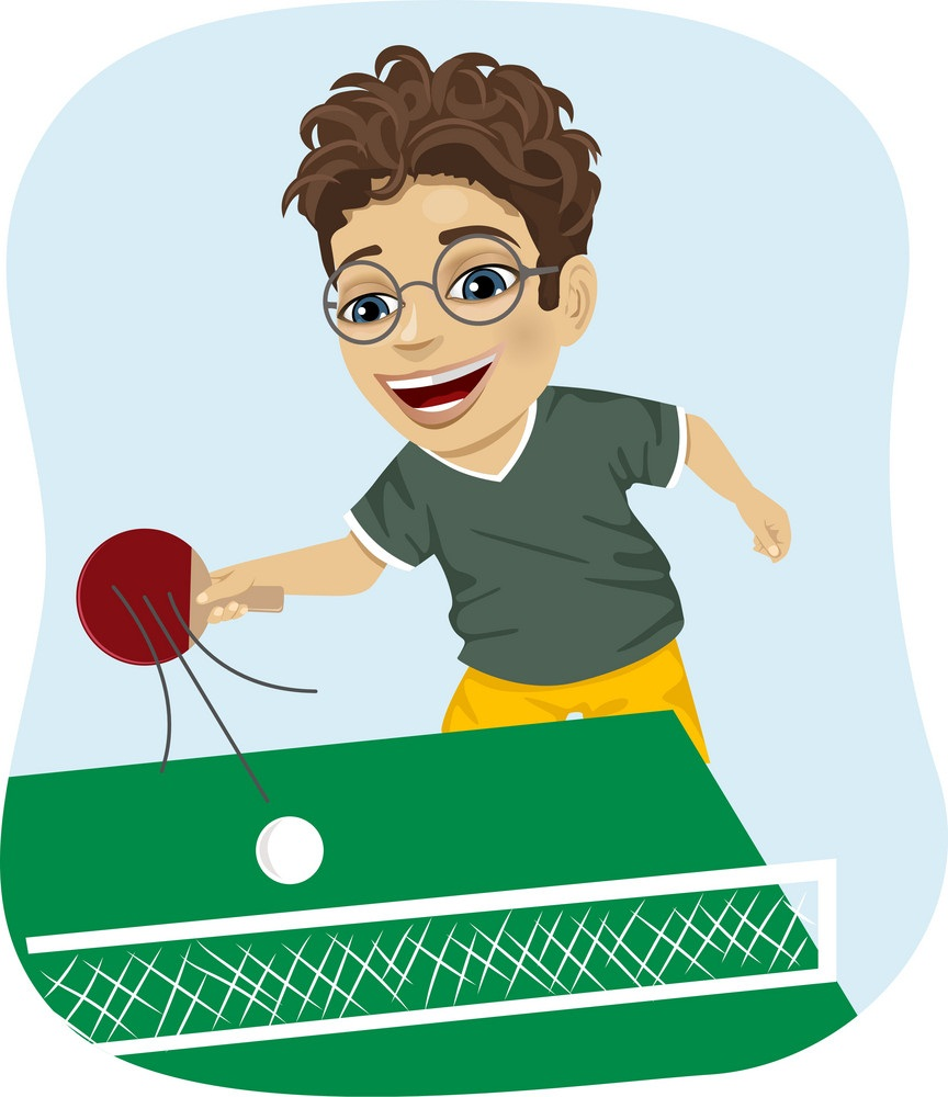 smiling boy playing table tennis