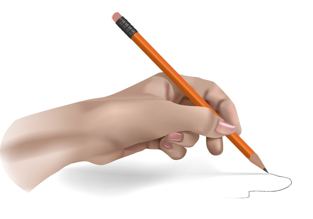 hand holding pencil and writing