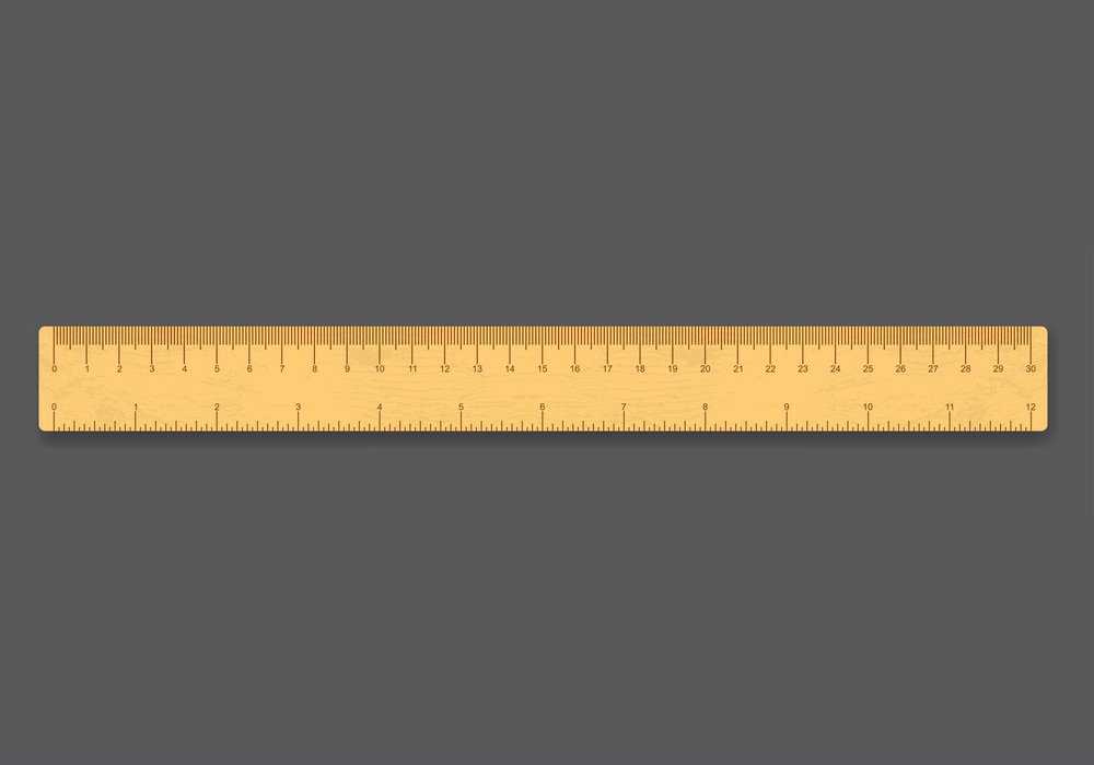 wooden ruler on gray background