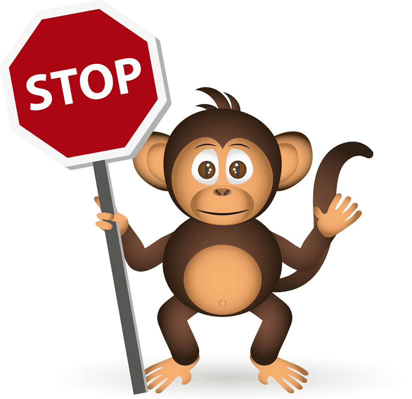 Monkey holding Stop Sign clipart